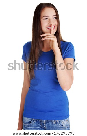 Hush be quiet woman isolated. Teen girl with finger on her lips looking on side and smiling.  - stock photo