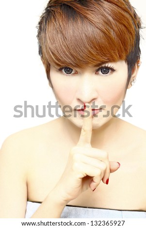 HUSH,Pretty women short hair with her finger over her mouth - stock photo