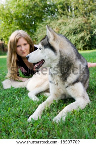 husky and owner. focus on dog - stock photo