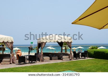Hut at the beach at luxury hotel, Fujairah, UAE - stock photo