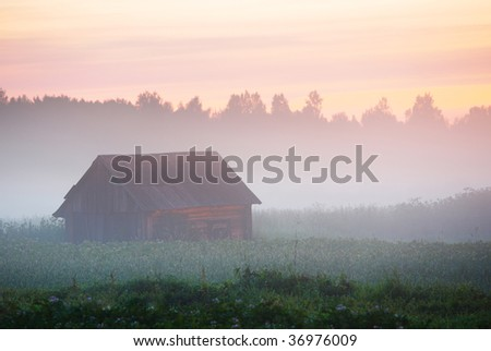 Hut in the fog - stock photo