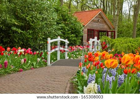 hut in the spring flower garden Keukenhof, Netherlands - stock photo
