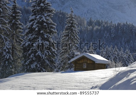 hut in winter - stock photo