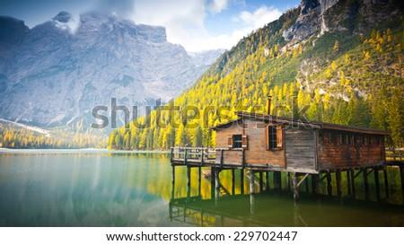 Hut on Braies lake and Dolomiti in autumn, Trentino Alto Adige, Italy - stock photo