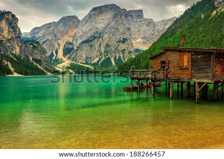 Hut on Braies Lake in Dolomiti mountains and Seekofel in background,Sudtirol,Italy - stock photo