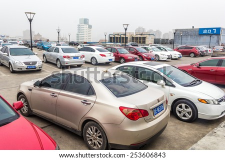 HUZHOU,CHINA - FEB 17: Parking uncovered on February 17th 2015 in Huzhou.China's automobile market over the next 10 years will be an annual growth rate of around 12%. - stock photo