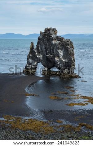 Hvitserkur, giant rock with the shape of a dinosaur at Hunafjoraur - stock photo