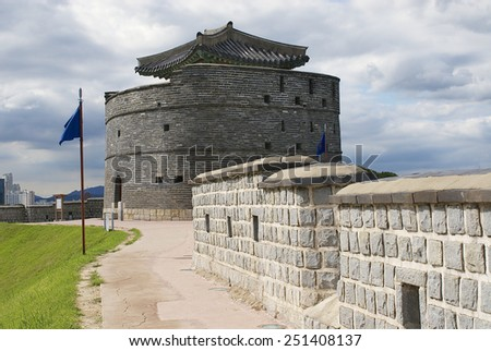 Hwaseong fortress (Brilliant Fortress) exterior wall and tower in Suwon, South Korea. Built in the late 18th century, UNESCO World Heritage Site. - stock photo