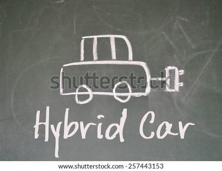 hybrid car sign on blackboard - stock photo
