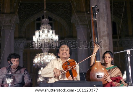 HYDERABAD,AP,INDIA-APRIL 20:Dr. L. Subramaniam performing during Heritage week celebrations at Chowmahalla Palace,built in1880 on April 20,2012 in Hyderabad,Ap,India. Well known violinist in India. - stock photo