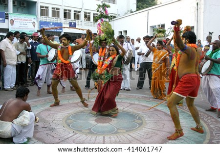 HYDERABAD,AP,INDIA-OCTOBER 27:Hindu people enact carrying bonam during inaguration of four-day Kalarchana by Bharateeyam on October27,2012 in Hyderabad,India.Event promoting culture and tradition. - stock photo
