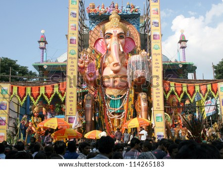 HYDERABAD,AP,INDIA- SEPTEMBER 28:People pray to 58 feet high Lord Ganesh idol, at Khairatabad, during  Hindu festival on September 28,2012 in Hyderabad,India.This is one of the biggest idol made annualy. - stock photo