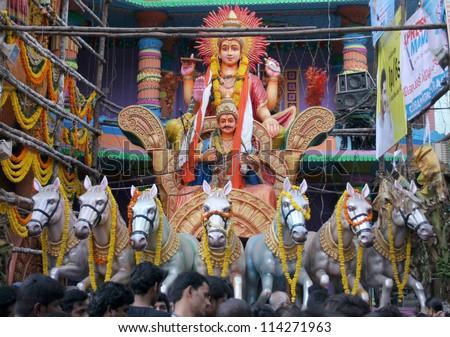 HYDERABAD,AP,INDIA- SEPTEMBER 28:People pray to Surya bhagavan  at 58 feet high Lord Ganesh idol, during ganesh chathurthi Hindu festival,of khairatabad,on 28,September 2012 in Hyderabad,India. - stock photo