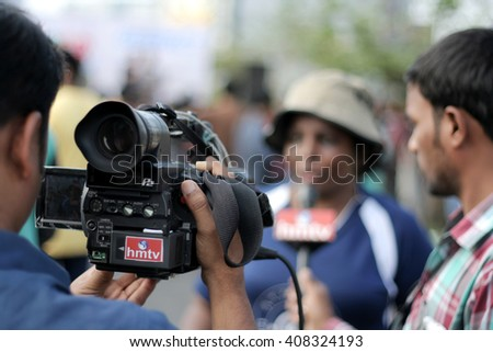 HYDERABAD,INDIA-APRIL10: TV channel press videographer shoot the interview of the organiser on raahgiri day,open roads program on March 10,2016 in Hyderabad,India. - stock photo