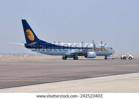 HYDERABAD, INDIA - DECEMBER 24, 2014: A Jet Airways Boeing 737 on the tarmac at Rajiv Gandhi International Airport. Jet Airways is the second largest Indian airline based in Mumbai. - stock photo