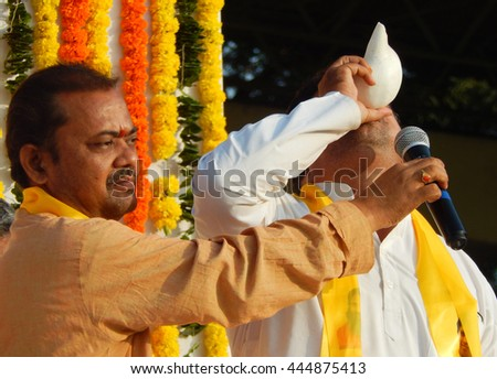 HYDERABAD,INDIA-JUNE 21:Indian Hindu blow conch to start yoga practice event in LB stadium during International Yoga Day event on June 21,2016 in Hyderabad,India                                 - stock photo