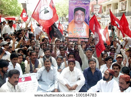 HYDERABAD, PAKISTAN - APR 16: Supporters of Jeay Sindh Qumi Mahaz (JSQM) are protesting in favor of their demands during demonstration on April 16, 2012 in Hyderabad. - stock photo