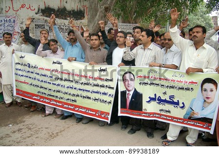HYDERABAD, PAKISTAN - DEC 01: Members of All Sindh Doctors and Paramedical Tutors Alliance are protesting in favor of their demands during a demonstration at Hyderabad on December 01, 2011. - stock photo