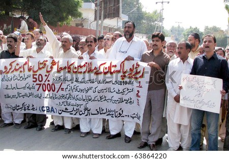 HYDERABAD, PAKISTAN - OCT 26: Radio (RP) employees chant slogans in favor of their demands during a protest demonstration arranged by United Staff Organization on October 26, 2010 in Hyderabad. - stock photo