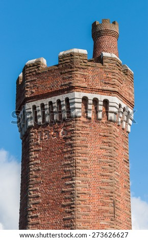 Hydraulic brick tower built in 1856 at the Wapping dock, Liverpool. It is a grade II listed building. - stock photo