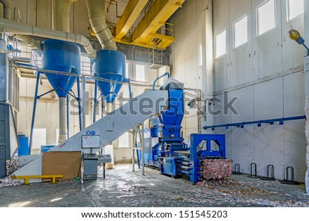 Hydraulic press for briquetting of paper waste - stock photo