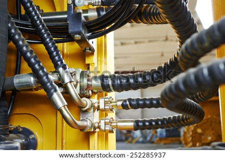 Hydraulic pressure pipes system of construction machinery - stock photo