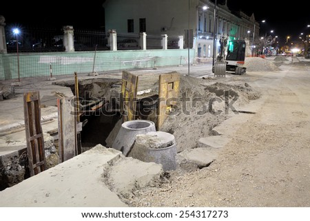 Hydro construction work, reconstruction of sewerage, night photo - stock photo
