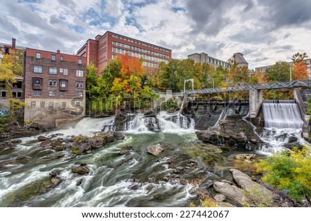 Hydro electric dam on Magog River in Sherbrooke city, Quebec, Canada with autumn colors - stock photo
