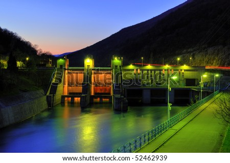 Hydro electricity plant at dusk - stock photo
