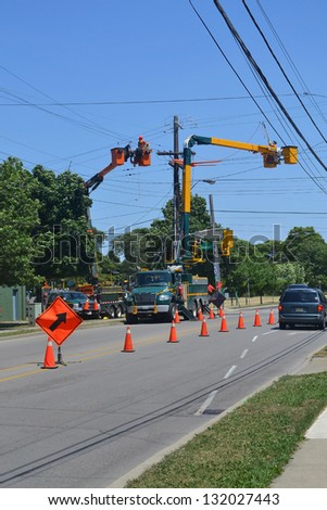 Hydro workers on power line in the city of Hamilton, Canada. - stock photo