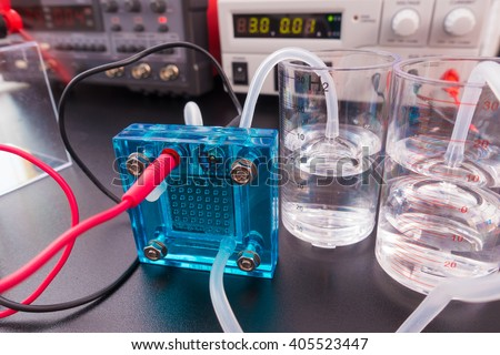 Hydrogen fuel cell, A fuel cell is a device that converts the chemical energy from a fuel into electricity  - stock photo