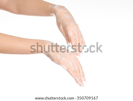 Hygiene and health protection topic: a woman's hand in soapsuds isolated on white background in studio - stock photo