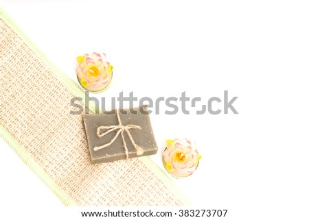 hygiene soap bar with wisp and candles. Spa background. Bath herbal toiletries for beauty, wellness, health. Scented natural cosmetics for body care, clean, wash. Freshness - stock photo