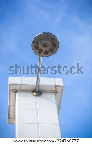Hygienic shower for washing sea water, outside, against blue sky - stock photo