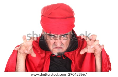 Hypnotist or sorcerer is doing hypnosis or magic with eyes and hands - stock photo