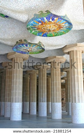 Hypostyle hall with mosaic sun at ceiling, at Guell Park, Barcelona, Spain. - stock photo