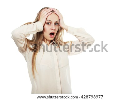 Hysterical woman expression with her hands on the head on a white isolated background - stock photo