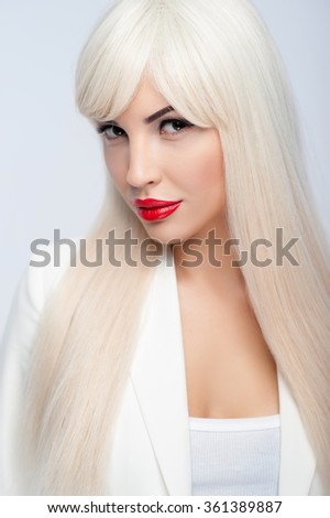 I am your dream. Portrait of attractive young woman looking forward with passion. She has long blond wig and red seductive lips. Isolated - stock photo