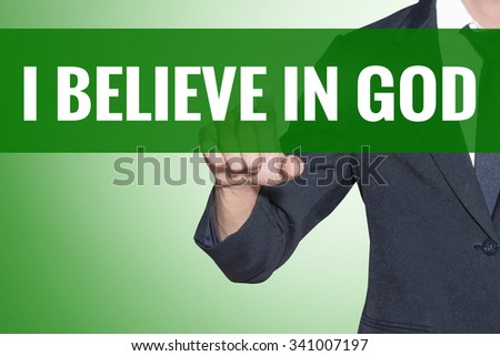 I believe in God word Business man point on green tab virtual screen - stock photo