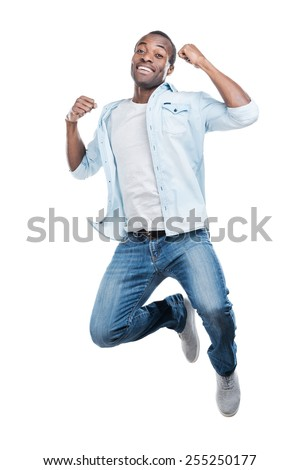 I did it! Full length of handsome young black man jumping against white background  - stock photo