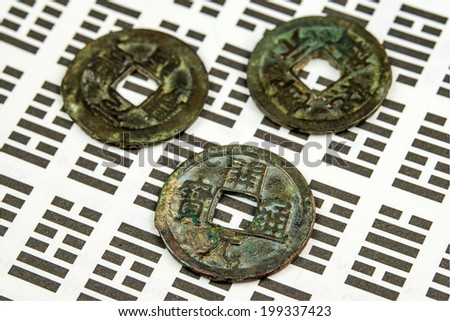 I Ging, Chinese divination with coins - stock photo
