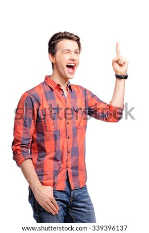 I got idea! Studio portrait of happy handsome young man pointing up. Isolated on white. - stock photo
