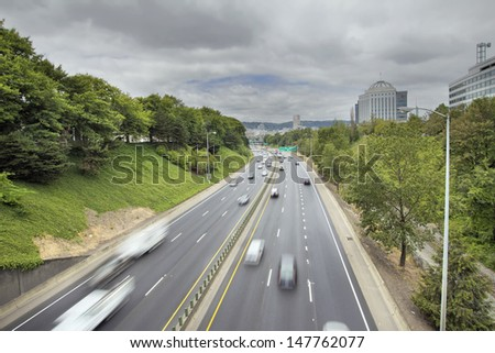 I-84 Interstate Freeway in Portland Oregon with Long Exposure Vehicle Traffic Motion - stock photo