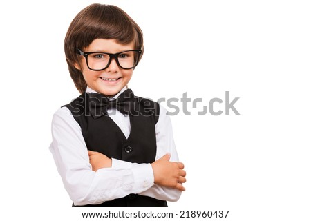 I know a lot of things. Portrait of young boy in bow tie looking at camera and smiling while isolated on white - stock photo