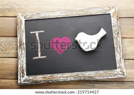 I love bird written on chalkboard, close-up - stock photo