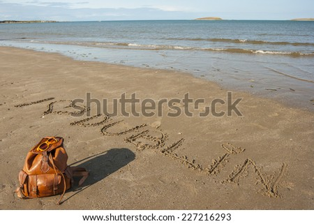 I love Dublin written on the sand, Backpack and glasses on the beach - stock photo