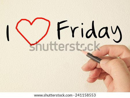 I love Friday text concept write on wall  - stock photo