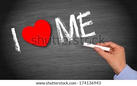I love me - phrase handwritten on chalkboard - stock photo