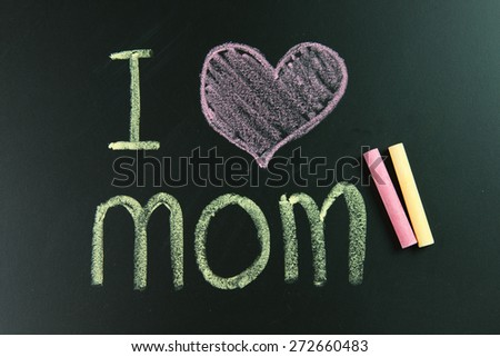 I love mom written on blackboard using chalk - stock photo