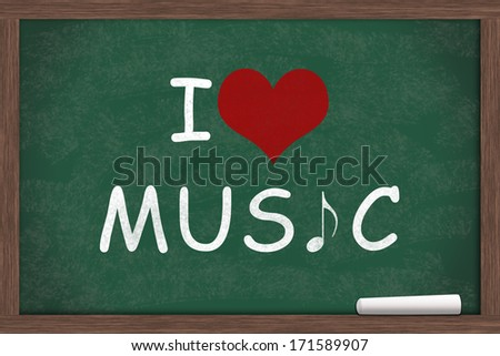 I love Music, I heart Music with music note symbol written on a chalkboard with a piece of white chalk - stock photo